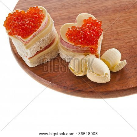 sandwich with red caviar in the form of a heart isolated on white