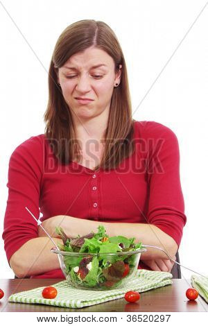 Woman who does not want to eat her healthy foods