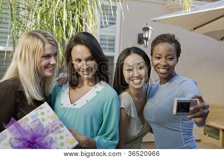 Women taking self-portrait at a baby shower