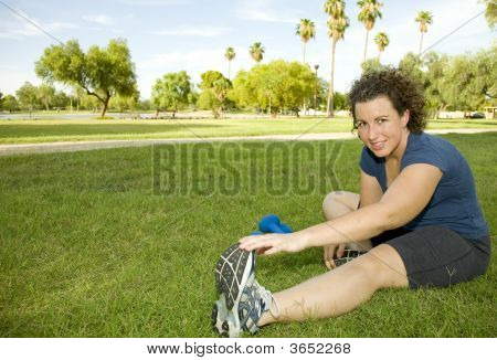 Young Woman Stretching Before Working Out