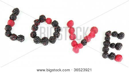 Word Lowe of raspberries and brambles close-up isolated on white