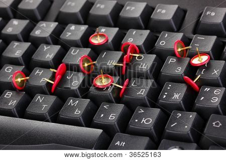 Painful typing, pins on keyboard close-up
