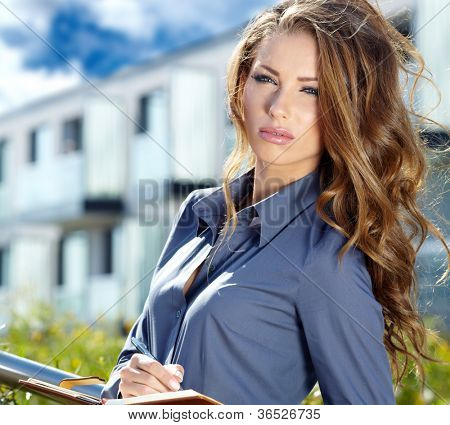 Portrait Of Female Estate Agent In Office