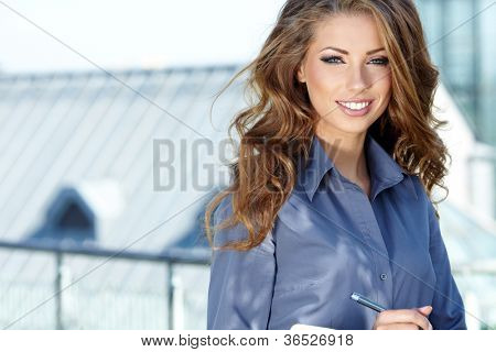 Portrait Of Female Estate Agent In Office