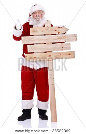 happy Santa Claus  holding wooden sign and showing thumb up, isolated on white background