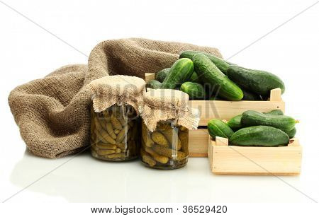 fresh cucumbers in boxes and pickles isolated on white