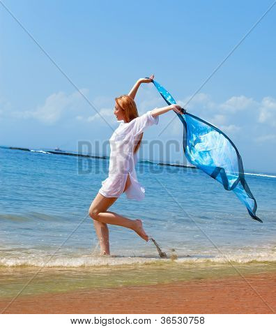 attractive woman with a beach scarf in hands