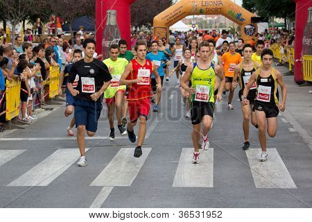 VALENCIA, SPAIN - SEPTEMBER 1: Runners compete in the 8 Kilometer XXVI Volta a Peu Quart de Poblet run on September 1, 2012 in Valencia, Spain.