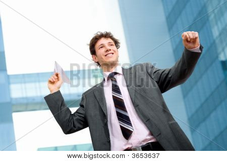 Businessman Throwing Paper Airplane