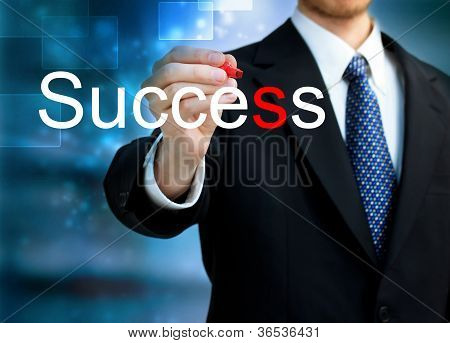 Young Business Man Writing The Word Success