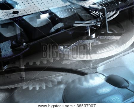 Composite image showing broken timer clockwork overlaid onto mouse and keyboard.