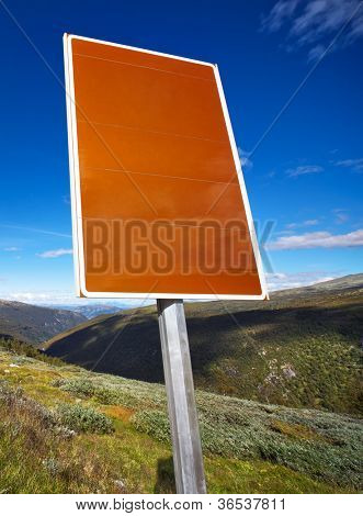 Road sign with textspace. On Norway mountain background.