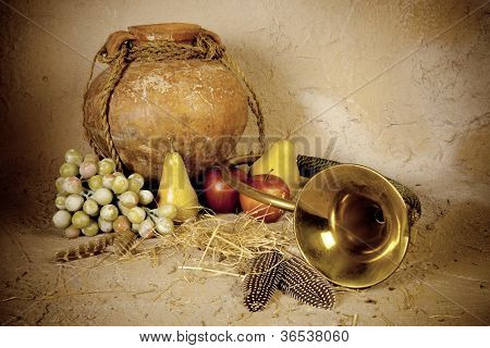 Grunge and discolored autumn still life with hunting horn