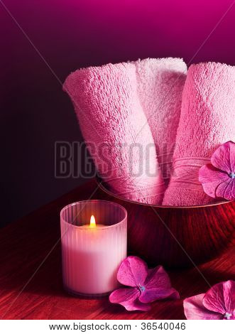 Photo of pink spa background, picture of zen candle light, image of fresh soft towel on wooden table, bath accessories, aromatherapy, health and beauty care, luxury spa resort, harmony concept
