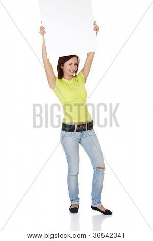 Happy smiling young woman showing blank signboard, over white background