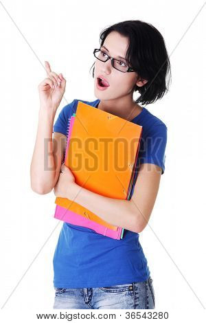 Student woman with coloured note pad pointing up. Surprised.