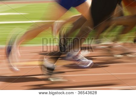 Blurred motion of male athletes racing