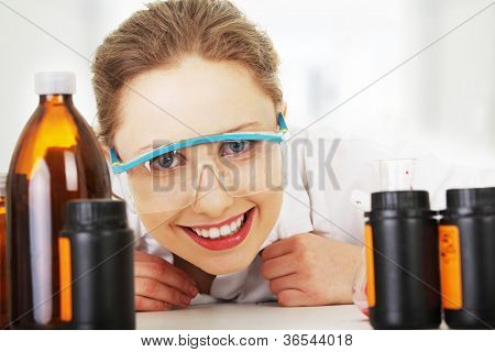 Portrait of a smiling chemist working at laboratory