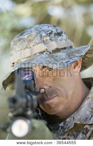 Soldier pointing the enemy with assault rifle on a mission