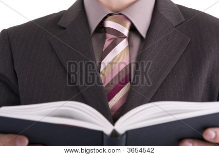 Businessman Looking At Book