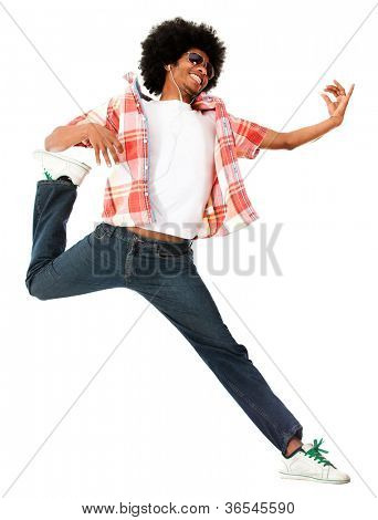 Funky afro man wearing earphones and listening to music - isolated over white