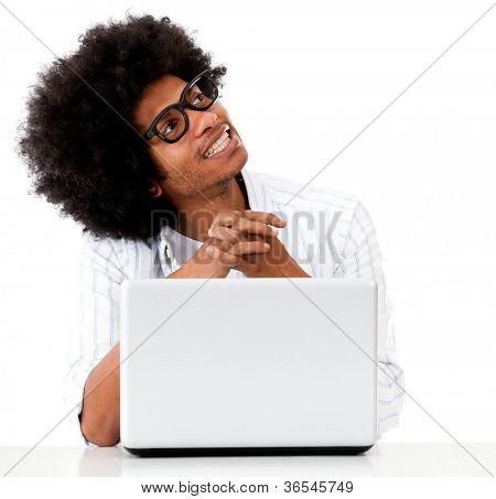 Thoughtful geek with a laptop - isolated over a white background