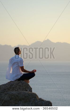 Man meditating by the sea