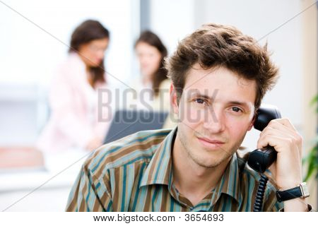 Businessman With Phone At Office
