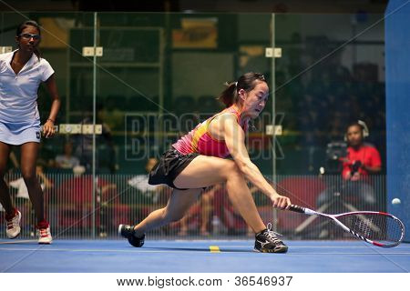 KUALA LUMPUR - SEPTEMBER 01: Low Wee Wern (red) takes on Vanessa Raj (white) at the TC Malaysian National Squash Championships 2012 played at the Arena Nicol David, Malaysia on September 01, 2012.