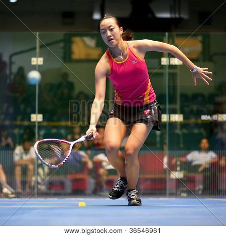 KUALA LUMPUR - SEPTEMBER 01: Low Wee Wern (red) retrieves a drop shot at the TC Malaysian National Squash Championships 2012 played at the Arena Nicol David, Malaysia on September 01, 2012.