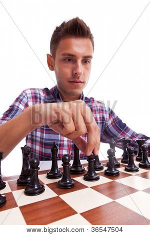 Young casual man preparing to make his first move. Isolated on white background.