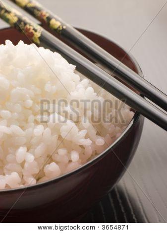 Bowl Of Koshihikari Rice With Chop Sticks