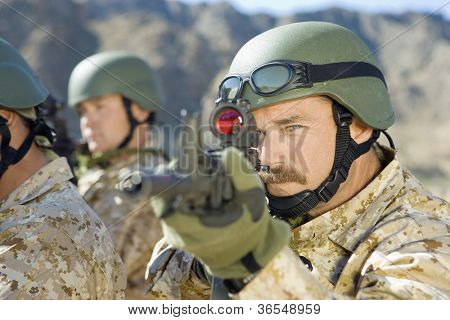 Soldiers with assault rifle on a mission