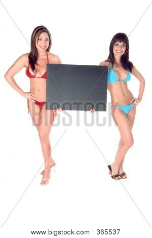 Two Hot Bikini Girls Holding Up Black Sign Board