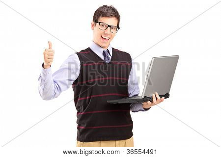Happy young man with laptop showing thumb up isolated on white background