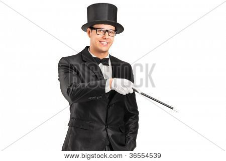 A magician holding a magic wand posing isolated on white background