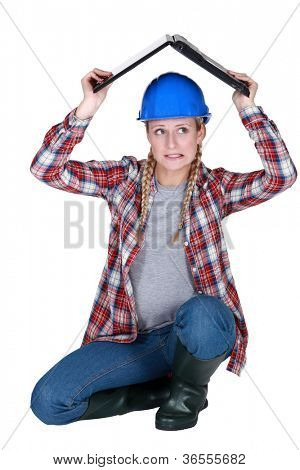 Tradeswoman covering her head