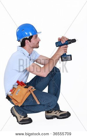 man using screwdriver