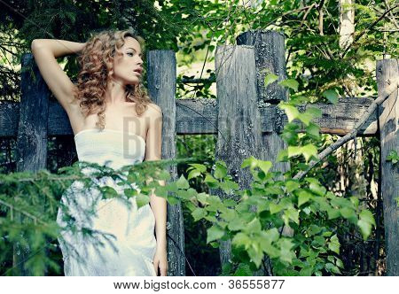 Portrait of beautiful blond woman in fairy forest