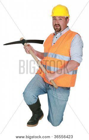 Worker using a pickaxe