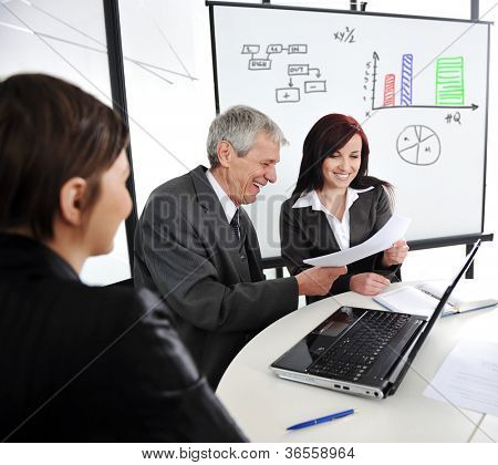 Business meeting with board presentation diagrams
