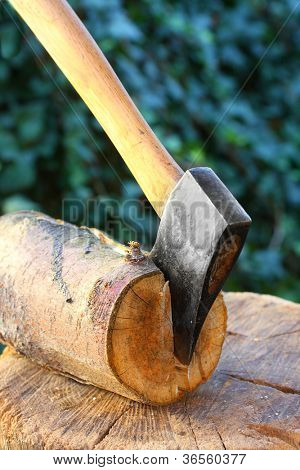 Cut log fire wood and old axe. Renewable resource of a energy. Environmental concept.