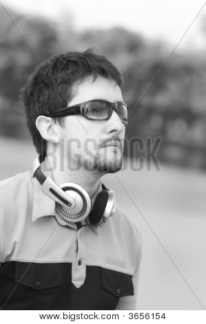 Young Man With Headphones In Black-And-White