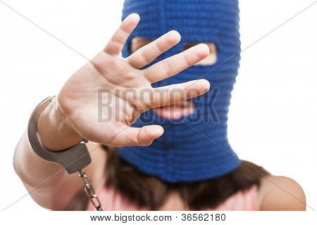 woman wearing balaclava or mask on head gesture shielding or showing stop sign white isolated