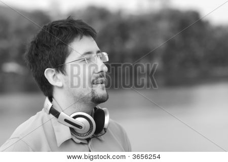 Young Smiling Man With Headphones In Black-And-White