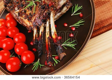 served charbroiled ribs on plate with vegetables