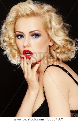Young beautiful stylish retro blond girl with surprised expression