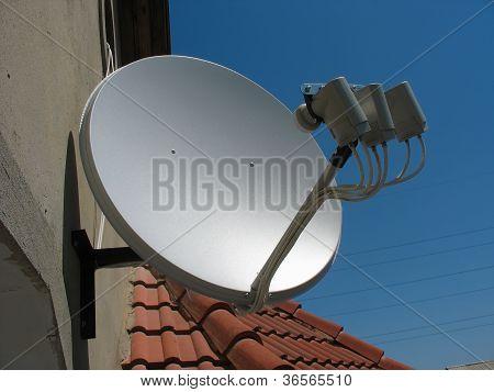 Satellite Dish Antenna Over Blue Sky