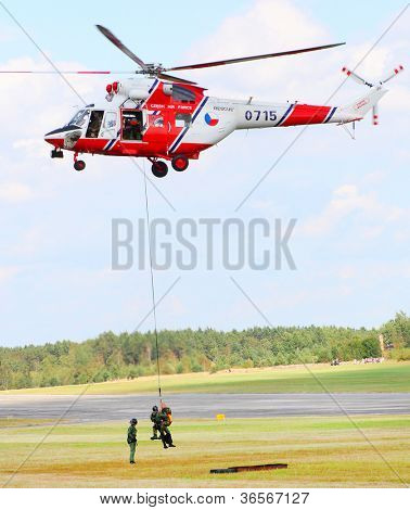 PILSEN, CZECH REPUBLIC - AUGUST 25: Modern polish rescue helicopter W-3A Sokol and rescue team, Pilsen Aeronautical Days on August 25, 2012 in Pilsen , Czech Republic.