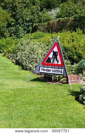 Hedge Cutting Sign In Country Garden